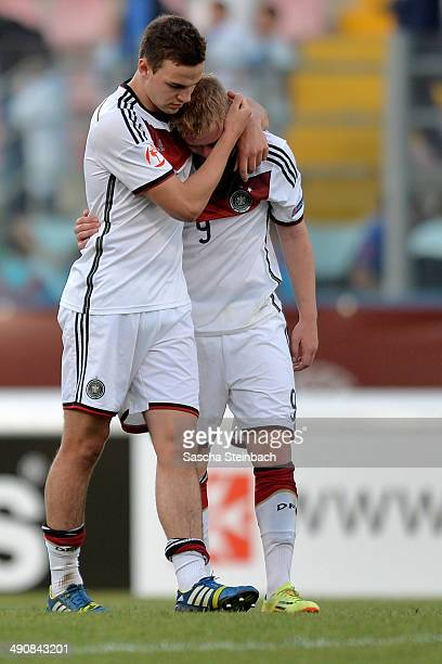 Benedikt Gimber and Phillipp Ochs of Germany react after losing their UEFA Under17 European Championship 2014 group B match against Portugal at Ta'...