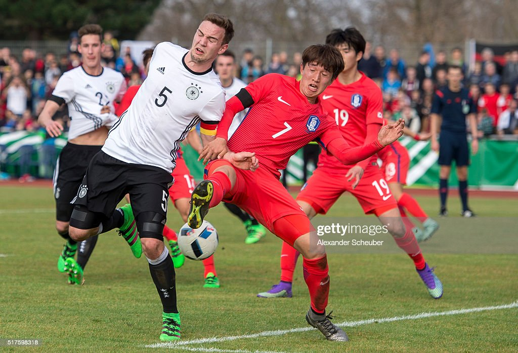 Benedikt Gimber of Germany challenges Hanbin Park of South Korea during the international friendly match between Germany and South Korea on March 26, 2016 in Ingelheim, Germany.