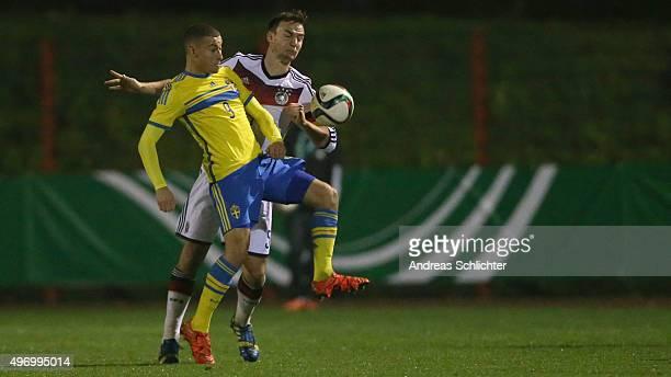 Benedikt Gimber of Germany challenges Jordan Larsson of Sweden during the U19 FourNationsCup Germany vs Sweden on November 13 2015 in Voelklingen...