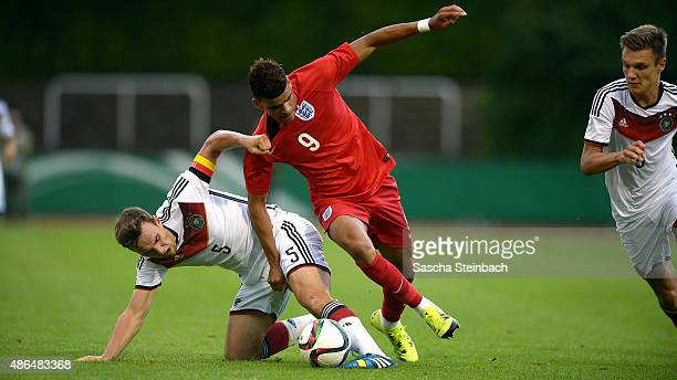 Benedikt Gimber of Germany is challenged by Dominic Solanke of England during the U19 international friendly match between Germany and England on...