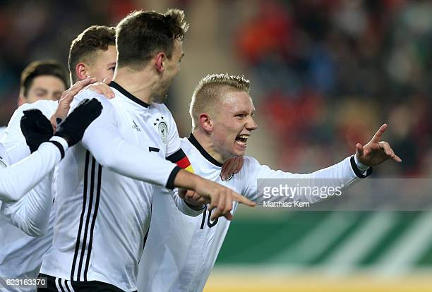 Benedikt Gimber of Germany jubilates with team mate Philipp Ochs after scoring the first goal during the U20 international friendly match between...