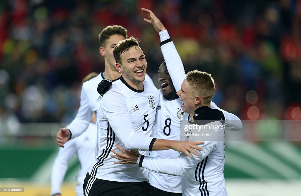 Benedikt Gimber (L) of Germany jubilates with team mates after scoring the first goal during the U20 international friendly match between Germany and Poland at Stadion Zwickau on November 14, 2016 in Zwickau, Germany.