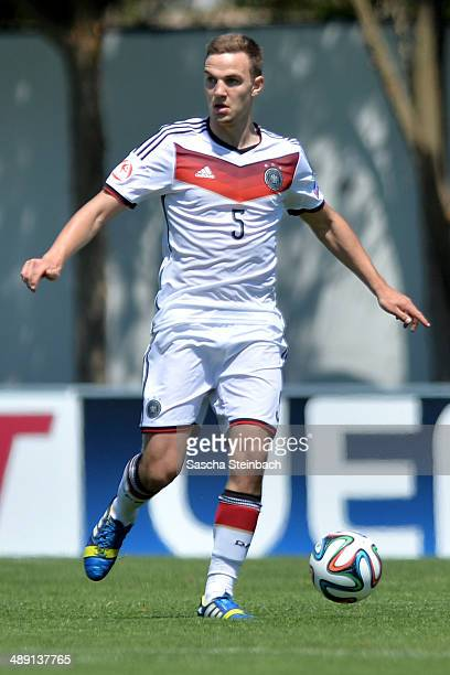 Benedikt Gimber of Germany runs with the ball during the UEFA Under17 European Championship 2014 group B match between Germany and Switzerland at...