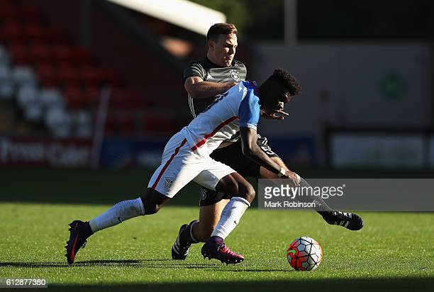 Benedikt Gimber of Germany tackles Emmanuel Sabbi of USA during the Under 20s Four Nations Tournament match between Germany and the United States at...