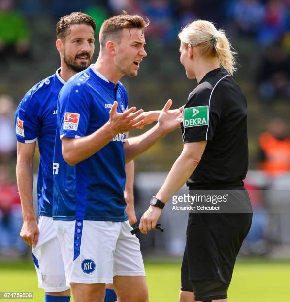 Benedikt Gimber of Karlsruhe discuss with Referee Bibiana Steinhaus during the Second Bundesliga match between Karlsruher SC and 1 FC Kaiserslautern...