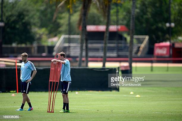 Benedikt Hoewedes and Aaron Hunt look on during a training session at Barry University on May 23, 2013 in Miami, Florida.