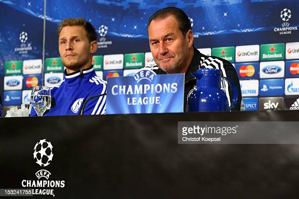 Benedikt Hoewedes and head coach Huub Stevens attend the press conference of FC Schalke 04 at the Veltins-Arena ahead of the UEFA Champions League...
