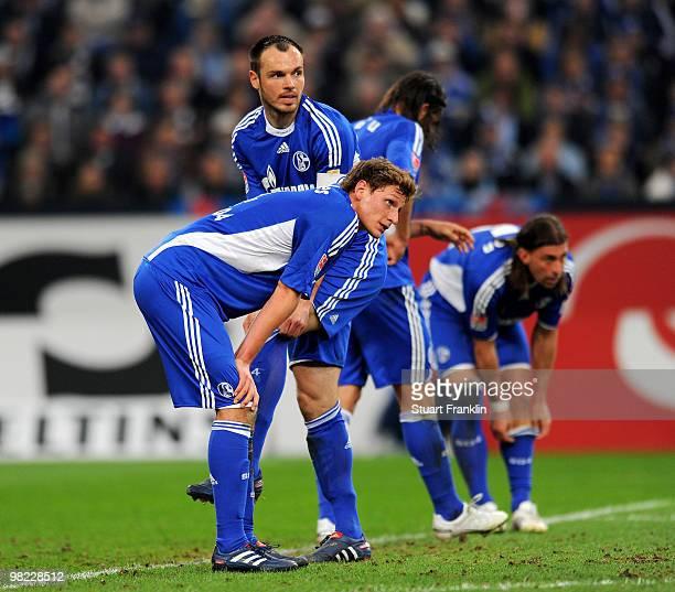 Benedikt Hoewedes and Heiko Westermann of Schalke look dejected during the Bundesliga match between FC Schalke 04 and FC Bayern Muenchen at the...