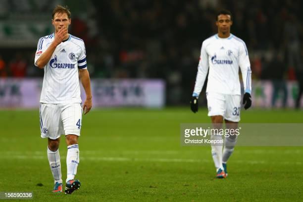 Benedikt Hoewedes and Joel Matip of Schalke look dejected after the Bundesliga match between Bayer 04 Leverkusen and FC Schalke 04 at BayArena on...