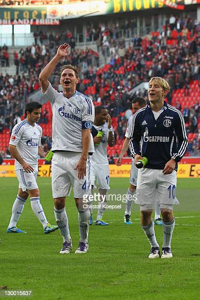 Benedikt Hoewedes and Lewis Holtby of Schalke celebrate the 10 vicgtory after the Bundesliga match between Bayer 04 Leverkusen and FC Schalke 04 at...