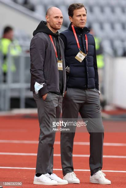 Benedikt Hoewedes and Oliver Bierhoff look on prior to the 2022 FIFA World Cup Qualifier match between Iceland and Germany at Laugardalsvollur...