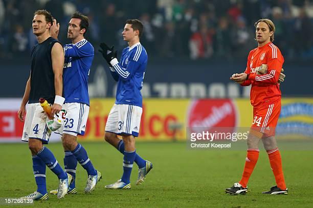 Benedikt Hoewedes Christian Fuchs Julian Draxler and Timo Hildebrand of Schalke look dejected after the Bundesliga match between FC Schalke 04 and...