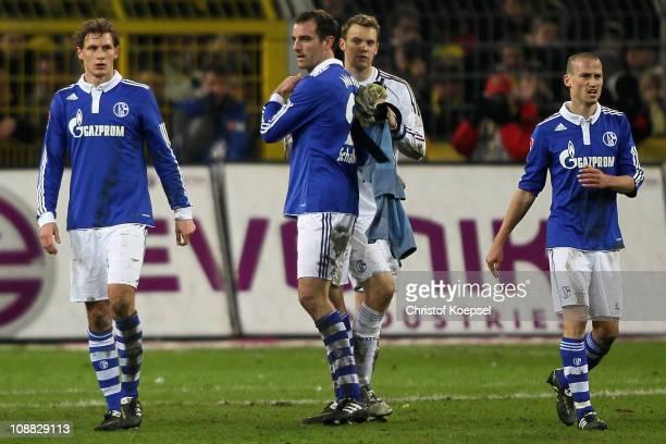 Benedikt Hoewedes, Christoph Metzelder, Manuel Neuer and Peer Kluge of Schalke celebrate the 0-0 draw after the Bundesliga match between Borussia...