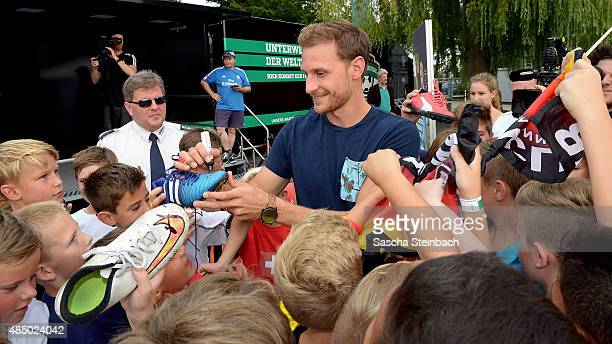 Benedikt Hoewedes gives autographs during the 'DFB Ehrenrunde' on August 23 2015 in Kamen Germany