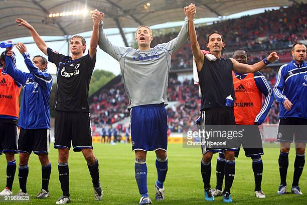 Benedikt Hoewedes goalkeeper Manuel Neuer and Kevin Kuranyi of Schalke celebrate the 21 victory after the Bundesliga match between VfB Stuttgart and...