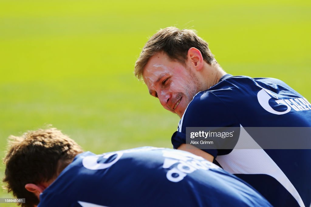 Benedikt Hoewedes has his face covered with sun lotion during a Schalke 04 training session at the ASPIRE Academy for Sports Excellenc on January 4, 2013 in Doha, Qatar.