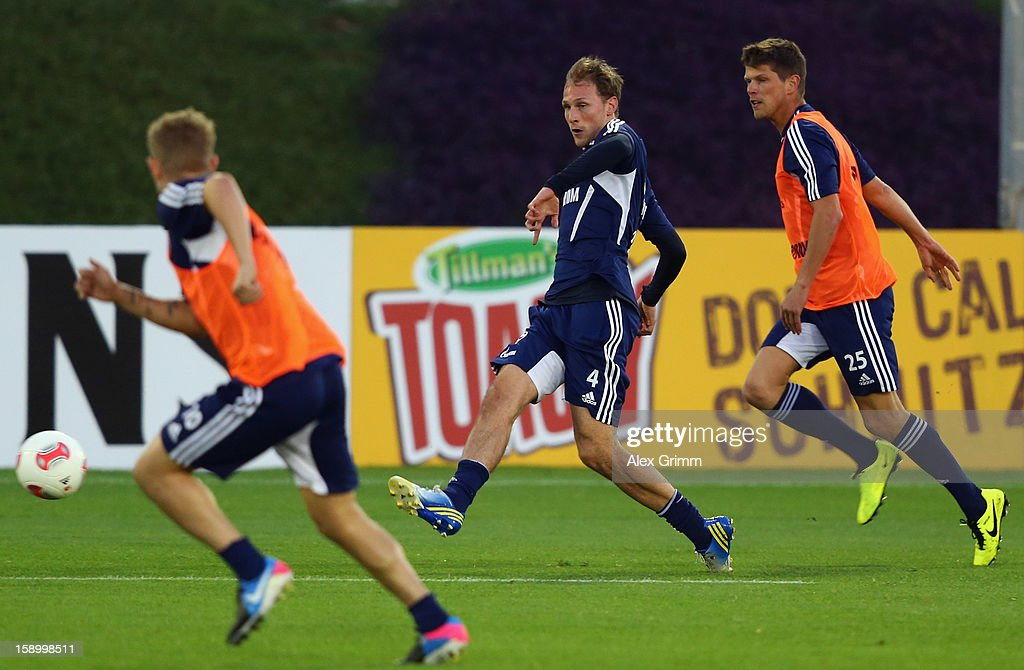 Benedikt Hoewedes (C) is challenged by Klaas-Jan Huntelaar (R) and Lewis Holtby during a Schalke 04 training session at the ASPIRE Academy for Sports Excellence on January 5, 2013 in Doha, Qatar.