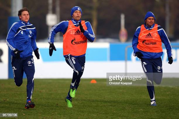 Benedikt Hoewedes Kevin Kuranyi and Edu of Schalke run during the training session of FC Schalke at the training ground of the Veltins Arena on...
