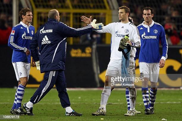 Benedikt Hoewedes, Mathias Schober, Manuel Neuer and Christoph Metzelder of Schalke celebrate the 0-0 draw after the Bundesliga match between...