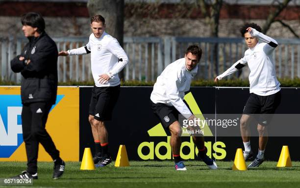 Benedikt Hoewedes Mats Hummels and Leroy Sane warm up during a Germany training session on March 24 2017 in Kamen Germany