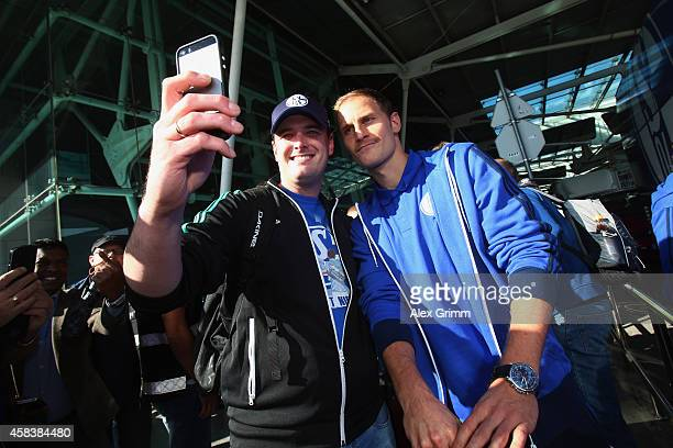 Benedikt Hoewedes of FC Schalke 04 arrives at Lisbon airport one day ahead of their UEFA Champions League Group G match against Sporting Club de...