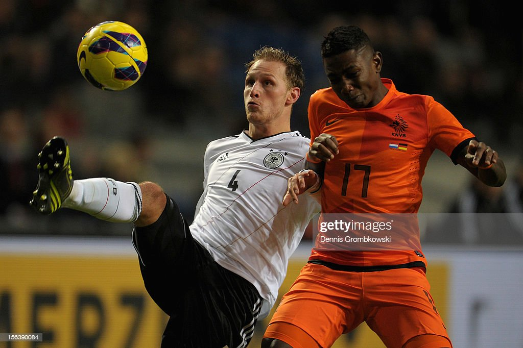 Benedikt Hoewedes of Germany and Eljero Elia of Netherlands battle for the ball during the International Friendly match between Netherlands and Germany at Amsterdam Arena on November 14, 2012 in Amsterdam, Netherlands.
