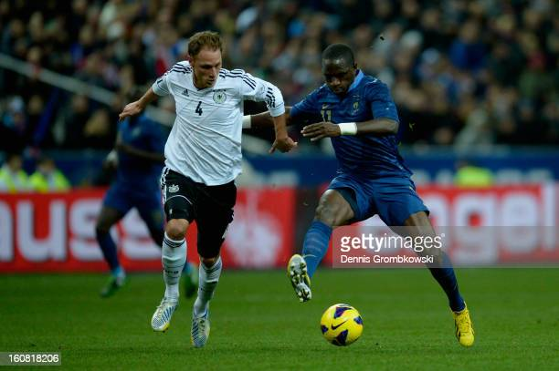 Benedikt Hoewedes of Germany and Moussa Sissoko of France battle for the ball during the international friendly match between France and Germany at...
