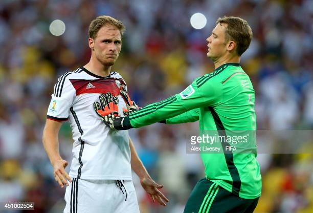 Benedikt Hoewedes of Germany celebates setting up his team's second goal with his teammate Manuel Neuer of Germany during the 2014 FIFA World Cup...
