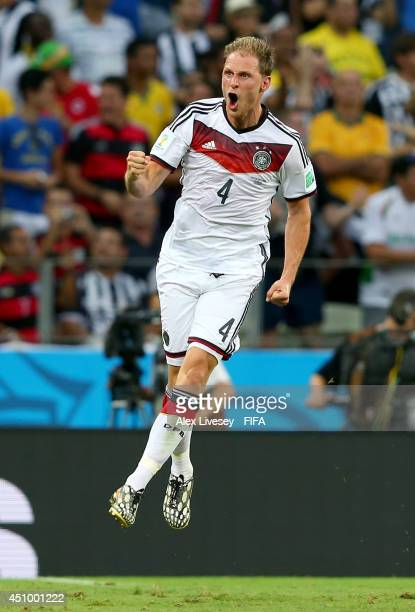 Benedikt Hoewedes of Germany celebrates assisting his team's second goal scored by Miroslav Klose during the 2014 FIFA World Cup Brazil Group G match...