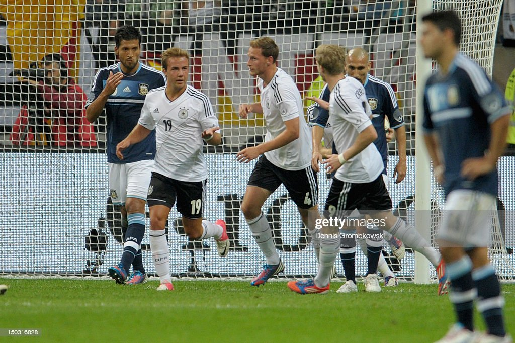 Benedikt Hoewedes of Germany celebrates with teammate Mario Goetze after scoring his team's first goal during the international friendly match between Germany and Argentina and Commerzbank-Arena on August 15, 2012 in Frankfurt am Main, Germany.