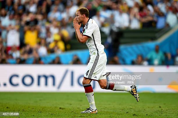 Benedikt Hoewedes of Germany reacts after his head hitting a post during the 2014 FIFA World Cup Brazil Final match between Germany and Argentina at...