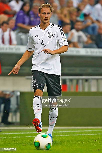 Benedikt Hoewedes of Germany runs with the ball during the FIFA 2014 World Cup Qualifying Group C match between Germany and Austria at Allianz Arena...