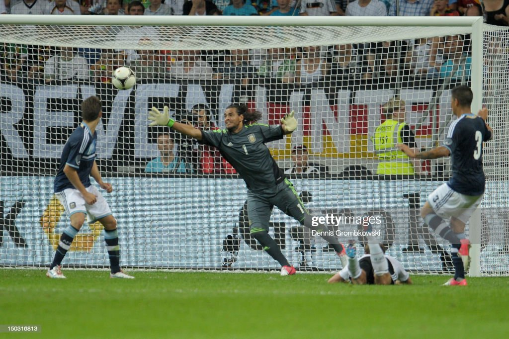 Benedikt Hoewedes of Germany scores his team's first goal during the international friendly match between Germany and Argentina and Commerzbank-Arena on August 15, 2012 in Frankfurt am Main, Germany.