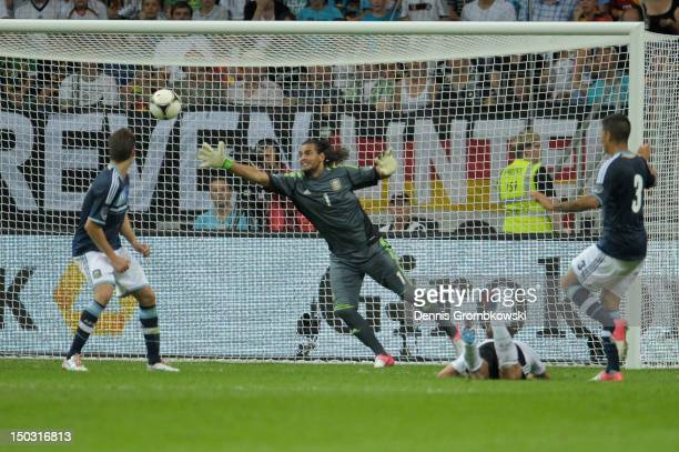 Benedikt Hoewedes of Germany scores his team's first goal during the international friendly match between Germany and Argentina and Commerzbank-Arena...