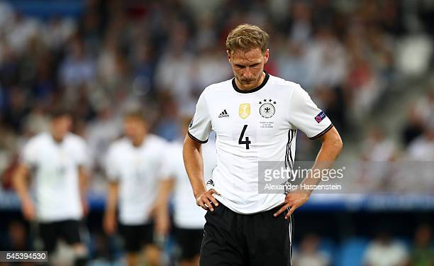 Benedikt Hoewedes of Germany shows his dejection after France's second goal during the UEFA EURO semi final match between Germany and France at Stade...