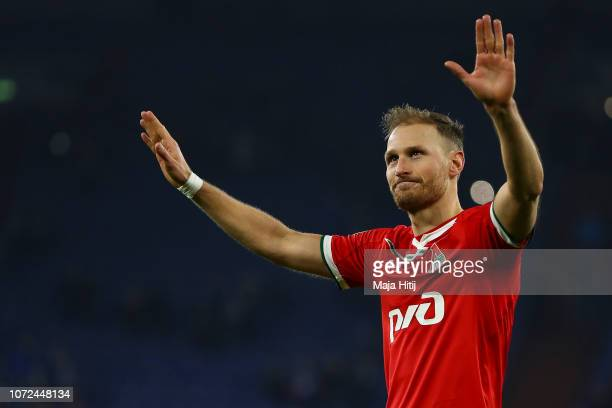 Benedikt Hoewedes of Lokomotiv Moscow shows appreciation to the fans after the UEFA Champions League Group D match between FC Schalke 04 and FC...
