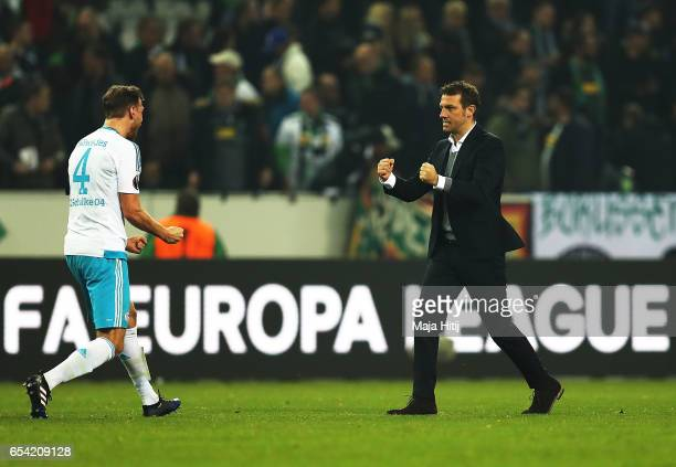 Benedikt Hoewedes of Schalke 04 celebrates with Markus Weinzierl after the UEFA Europa League Round of 16 second leg match between Borussia...