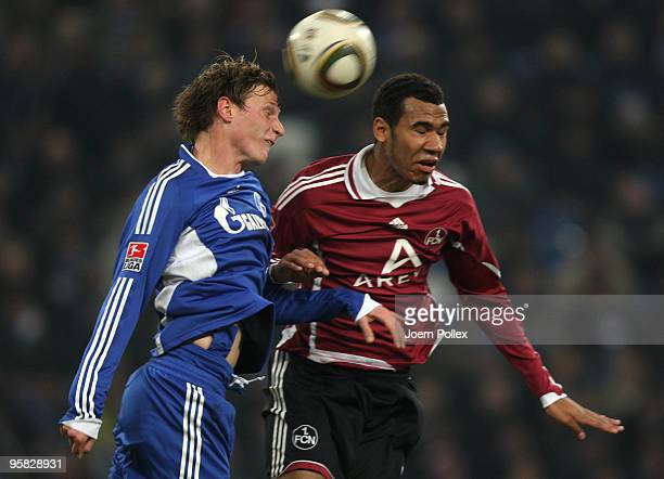 Benedikt Hoewedes of Schalke and EricMaxim ChoupoMoting of Nuernberg battle for the ball during the Bundesliga match between FC Schalke 04 and 1 FC...