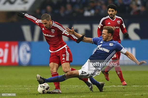 Benedikt Hoewedes of Schalke and Mathew Leckie of Ingolstadt for the ball during the Bundesliga match between FC Schalke 04 and FC Ingolstadt 04 at...