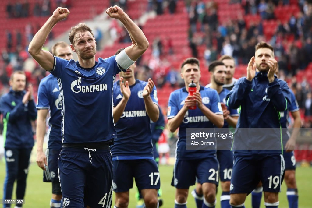 Benedikt Hoewedes of Schalke and team mates celebrate with the fans after the Bundesliga match between 1. FSV Mainz 05 and FC Schalke 04 at Opel Arena on March 19, 2017 in Mainz, Germany.