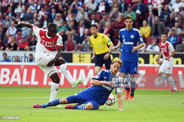 Benedikt Hoewedes of Schalke blocks a shot of Anthony Ujah of Koeln during the Bundesliga match between 1 FC Koeln and FC Schalke 04 at...