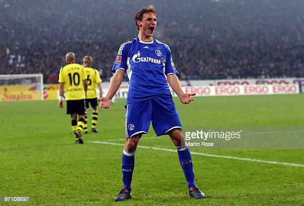 Benedikt Hoewedes of Schalke celebrates after scoring his team's first goal during the Bundesliga match between FC Schalke 04 and Borussia Dortmund...