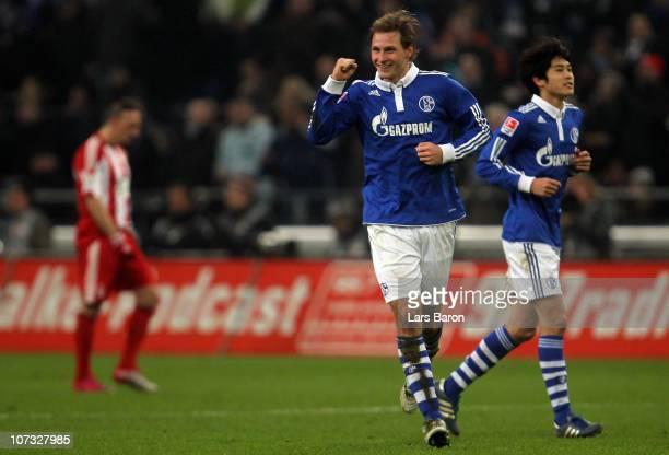 Benedikt Hoewedes of Schalke celebrates after scoring his teams second goal during the Bundesliga match between FC Schalke 04 and FC Bayern Muenchen...