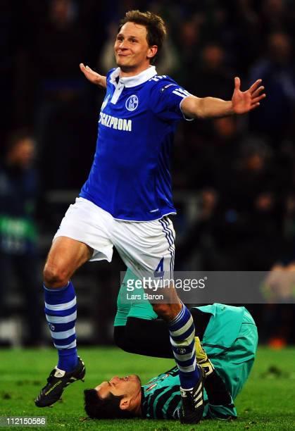 Benedikt Hoewedes of Schalke celebrates after scoring his teams second goal during the UEFA Champions League quarter final second leg match against...