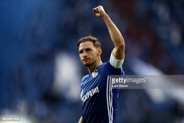 Benedikt Hoewedes of Schalke celebrates after winning the Bundesliga match between FC Schalke 04 and FC Augsburg at VeltinsArena on March 12 2017 in...