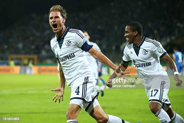 Benedikt Hoewedes of Schalke celebrates his team's second goal with team mate Jefferson Farfan of Schalke during the DFB Cup second round match...