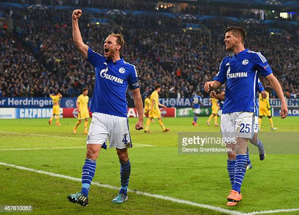 Benedikt Hoewedes of Schalke celebrates scoring their third goal with Klaas Jan Huntelaar of Schalke during the UEFA Champions League Group G match...