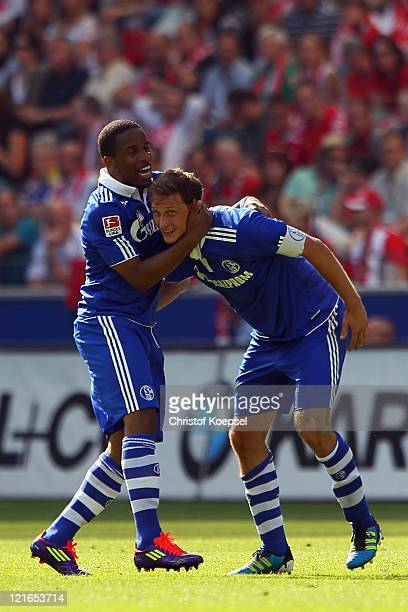 Benedikt Hoewedes of Schalke celebrates the second goal with Jefferson Farfan during the Bundesliga match between FSV Mainz 05 and FC Schalke 04 at...