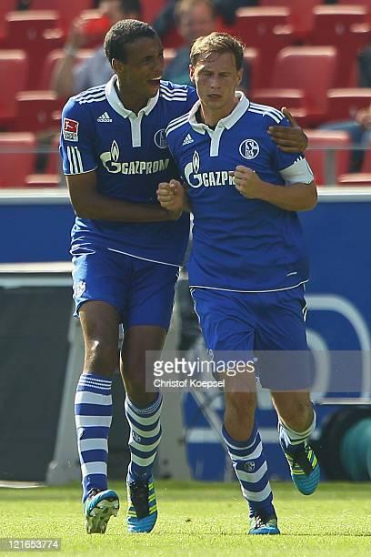Benedikt Hoewedes of Schalke celebrates the second goal with Joel Matip during the Bundesliga match between FSV Mainz 05 and FC Schalke 04 at Coface...