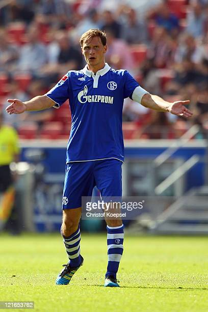 Benedikt Hoewedes of Schalke celebrates the second goal with the fans during the Bundesliga match between FSV Mainz 05 and FC Schalke 04 at Coface...